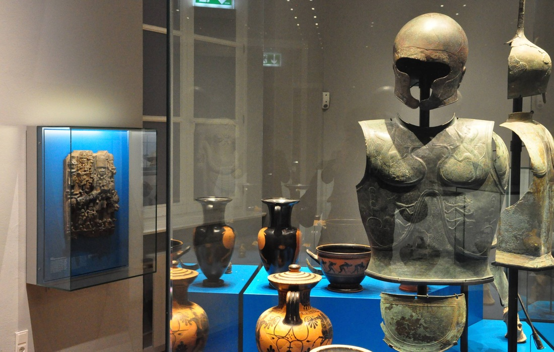 Relief from Benin (L), vases and armor from ancient Greece (R). Museum Of Arts And Crafts, Hamburg